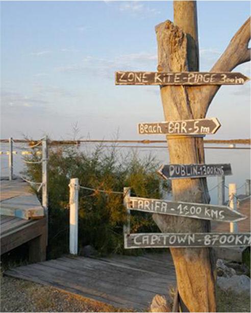 bar bord plage panneaux distances villes mondiales
