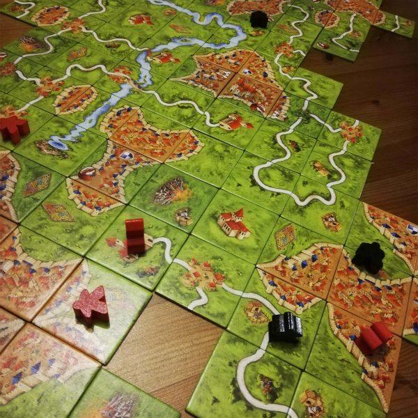 Jouer au jeu de société Carcassonne ©ADT de l'Aude