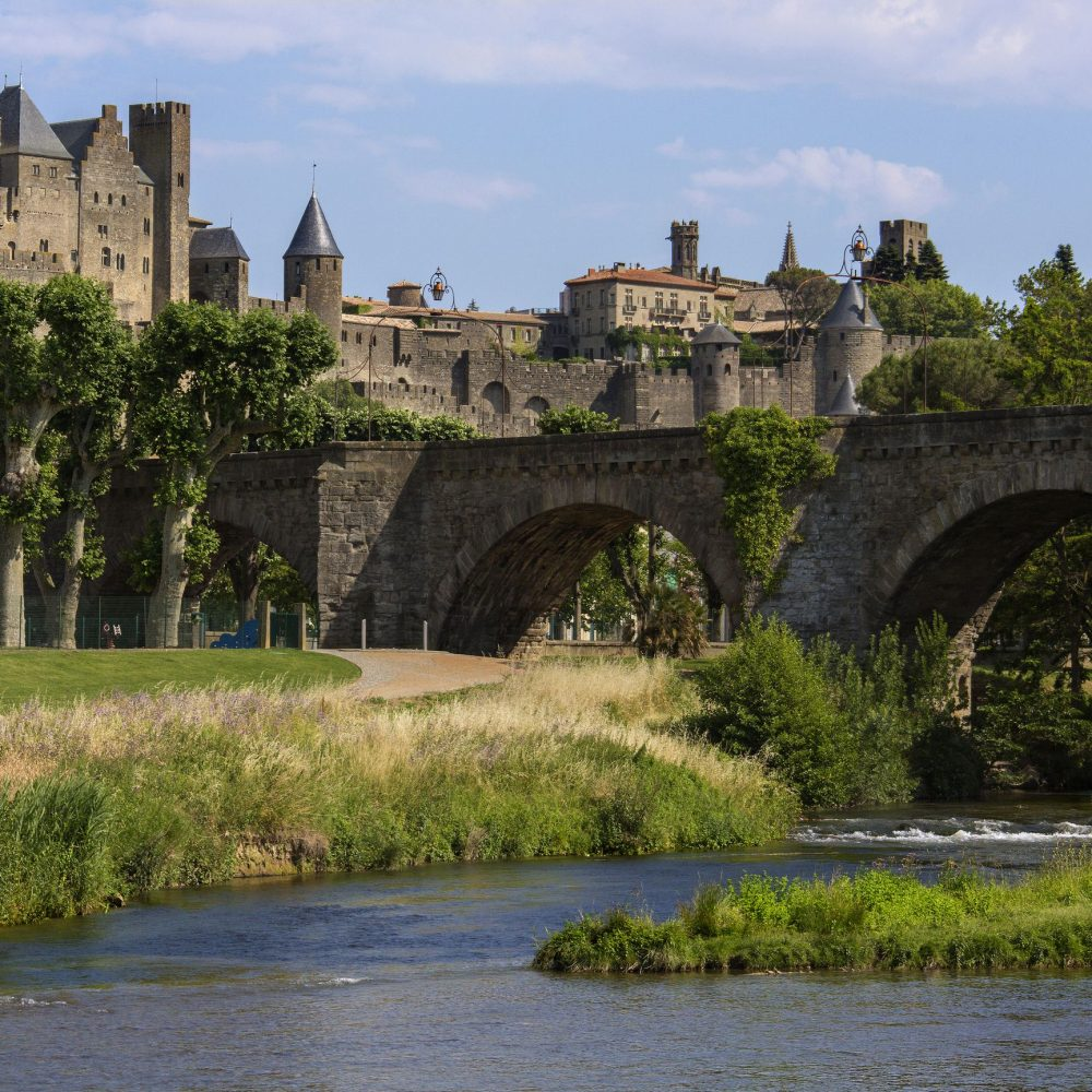 The medieval fortress and walled city of Carcassonne in south west France. Founded by the Visigoths in the fith century, it was restored in 1853 and is now a UNESCO World Heritage Site. Viewed over the Pont Vieux crossing the Aude River.
